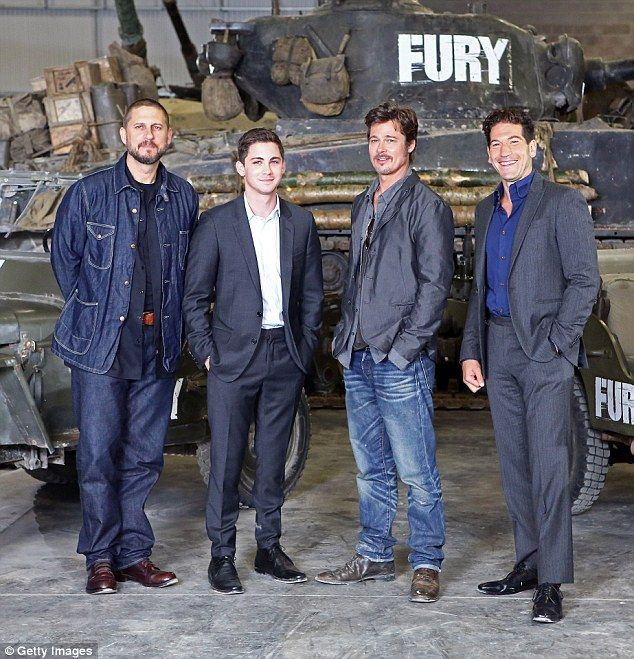 Leading men: Brad made a quick stop to promote his WWII film alongside David Ayer, Logan Lerman and Jon Bernthal following his wedding