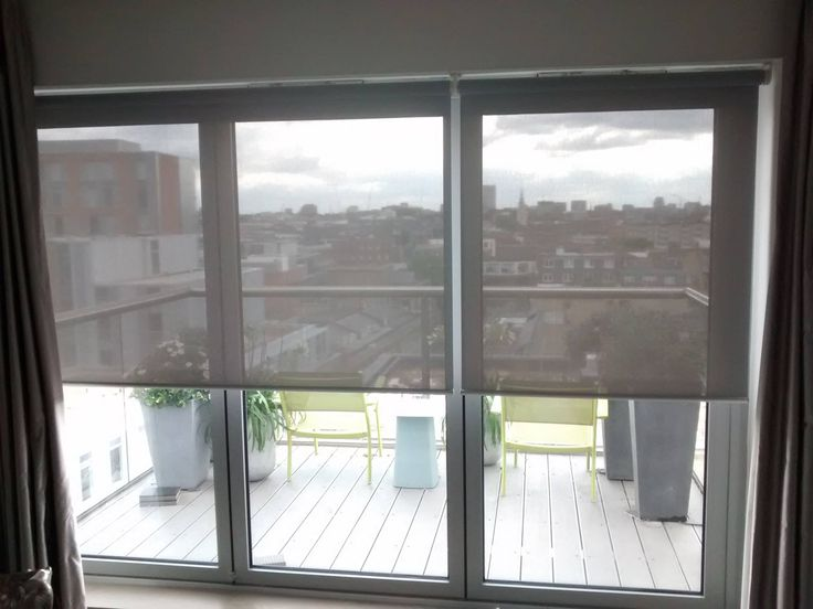 sunscreen roller blinds installed to bifold doors in a penthouse apartment in london http