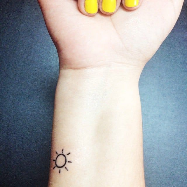 Pin for Later: 100 Real-Girl Tiny Tattoo Ideas For Your First Ink Ray of Sun