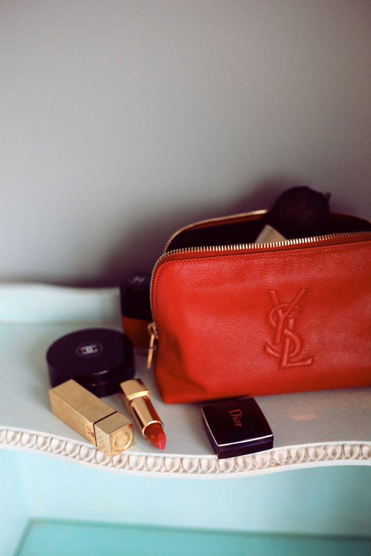 Makeup bag essentials. What is a girl to do without her Chanel & YSL ? xx Dressed to Death xx #fashion #red #style