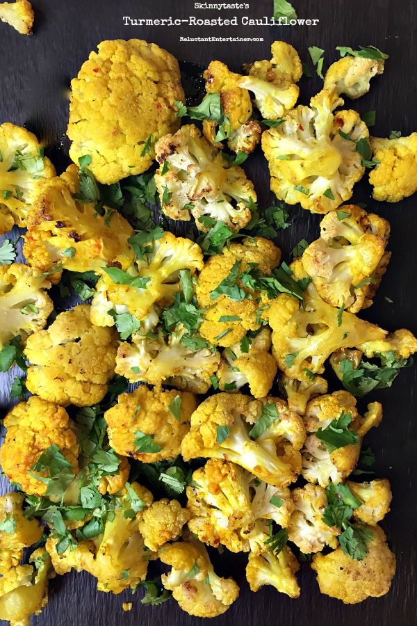 Skinnytaste's Turmeric-Roasted Cauliflower: 6 heaping cups cauliflower florets (from 1-1/2 pound cauliflower) cut into 1-inch florets 3 garlic cloves, smashed 1/4 cup olive oil 1 tsp turmeric 1 tsp ground cumin Kosher salt, to taste 1/4 teaspoon crushed red pepper flakes 2 tbsp chopped cilantro DIRECTIONS: Preheat the oven to 450°F. Cut the cauliflower florets into 1-inch pieces and combine with the garlic in a large bowl. Drizzle with the olive oil and toss to coat. In a small bowl,