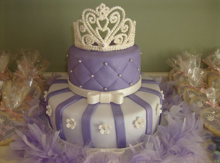 Purple Tiara Cake - This was my first tiara... it was really fun to make and a lot less intimidating once I got started.  This cake was for my daughter's 3rd birthday party.  I was really happy with the ovreall look of the cake.  It is covered in MMF and the other accents are wilton's fondant painted with luster dust.  Thanks for looking!