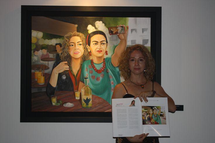 "Con mi cuadro: ""Frida y yo tomándonos una selfie"" oleo sobre tela 120 x 80 cms. 2015 Y el catalogo que el grupo Reforma distribuye en México Y Paris"