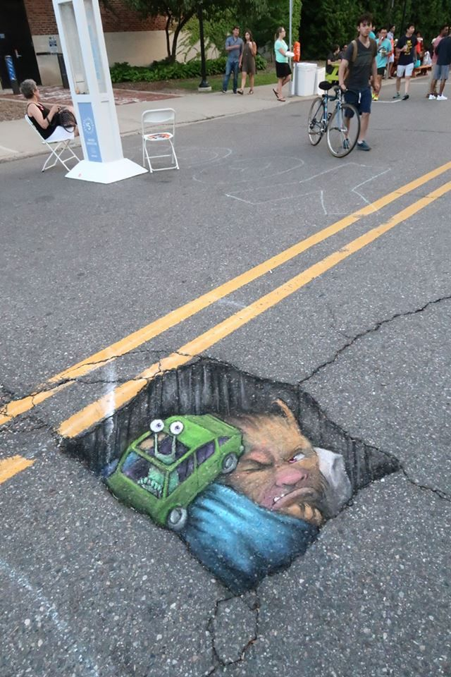David Zinn at Ann Arbor Summer Festival: Top of the Park. June 23, 2016 at 5:07pm -  Bad as hitting a pothole can be, it's worse if the one you hit is already occupied.