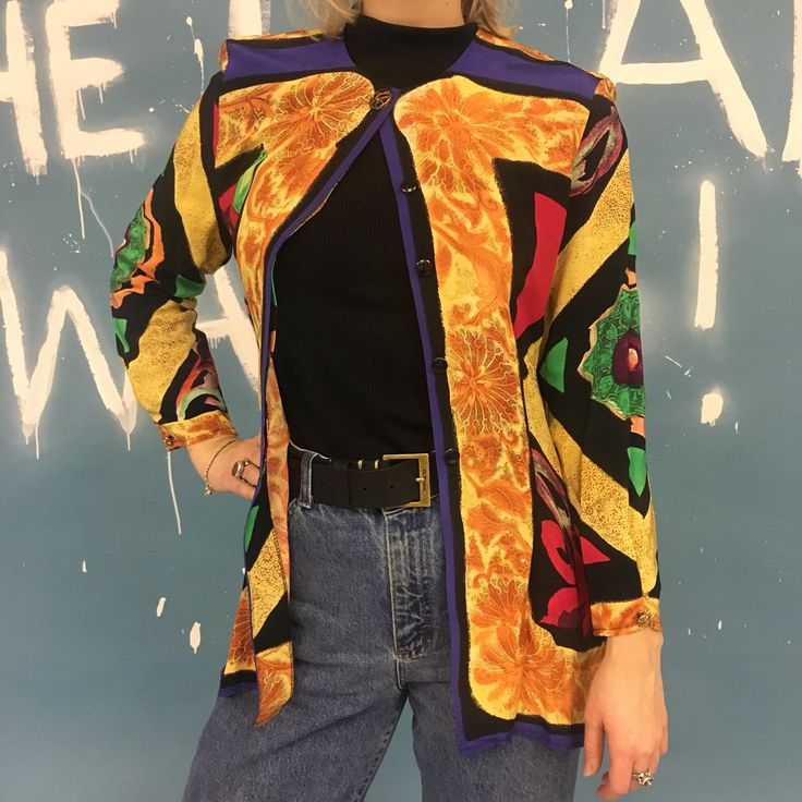 Late 80s / early 90s shoulder pad shirt - can be worn like a blazer or as a shirt Model is a size 10 and will fit up to a 12 #colour #truevintage #80s #90s #shirt #quirky #african #aztec #colourful #bright #zara #topshop - Depop