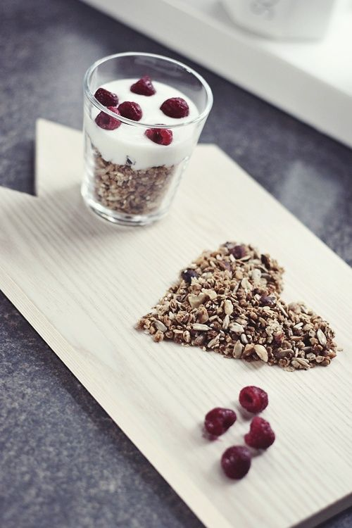 A healthy, full of fiber breakfast! Yoghurt with cereal and raspberries.  The setup - while we agree it might be a little too cutsy, is actually fun. And you can do it as a statement for morning humor :) Challenge taken?