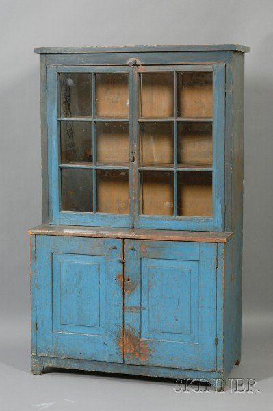 Blue-painted Pine Glazed Step-back Cupboard, probably New England, early 19th century, old surface, the interior painted a salmon color, (im...