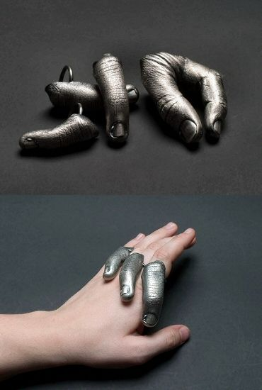 "More fingers, you say? Yes, just a pinch more. ""Pinch"" and ""hand-in-hand"" rings by Maryland jeweller Joanna Nealey."