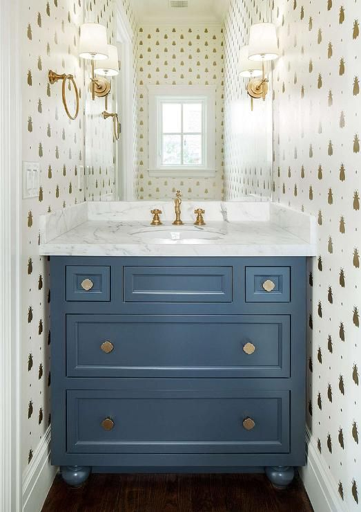 Lovely Blue And Gold Powder Room Features Walls Clad In Farrow U0026 Ball Bumblebee  Wallpaper Lined With