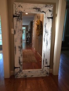 This used to be an ikea mongstad mirror. Painted, sanded and added some hardware.... Rustic old barn inspired mirror for hall! Bam!