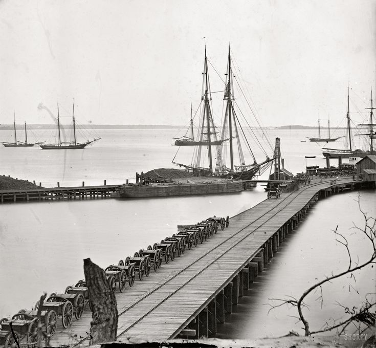 "1865. ""City Point, Virginia. Wharf, Federal artillery, and anchored schooners."" From photographs of the main Eastern theater of war, the siege of Petersburg, June 1864-April 1865. Wet plate glass negative."