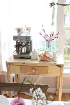 Set up a home coffee bar with an espresso machine and mugs.
