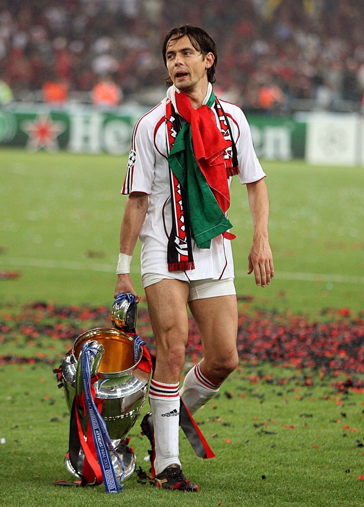 Filippo Inzaghi celebrates with the trophy on the pitch