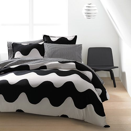 Providing the perfect harmony of soothing and stimulating elements, these waves will rock you to sleep tonight and get you on your feet tomorrow. Marimekko Lokki Black Percale Bedding - $140-250