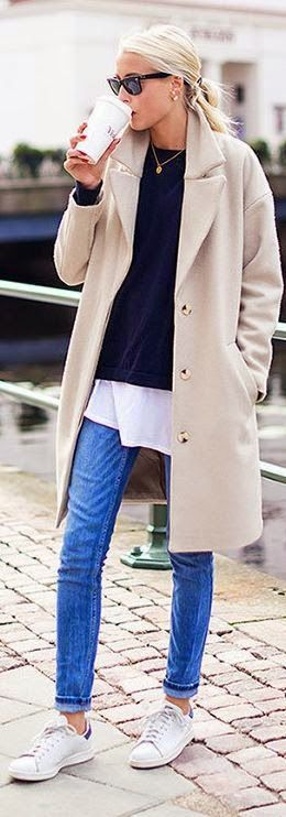 Neutral coat with layers underneath, black or printed sneaker