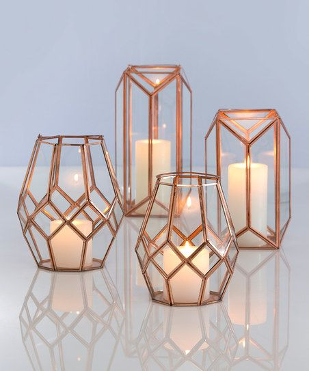 Add an extra-special touch to décor with this charming lantern that features sleek angles and a modern-edge design.