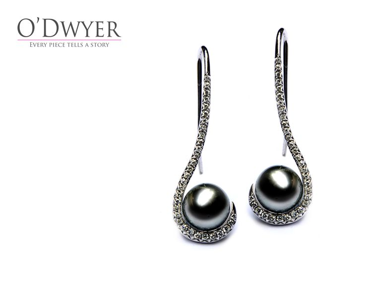 18ct white gold earrings with dark gray pearls and diamonds.