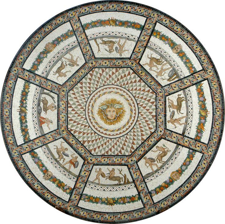Riproduzione di porzione di pavimento in mosaico della Sala Rotonda presso i Musei Vaticani. Mosaico realizzato in smalti filati per la medusa centrale, per le scene di satiri e per la fascia di foglie frutta, in marmi naturali per le decorazioni geometriche e il fondo bianco in autentico marmo palombi