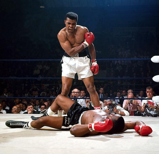 Muhammad Ali and Sonny Liston  Heavyweight Title Rematch  |  May 25, 1965  |  Photo By Neil Leifer/SI  In their heavyweight title rematch Ali defeated Liston by knockout in the first round. Ali would hold the heavyweight title until 1967, when he was stripped of it for refusing to be drafted into the Army.