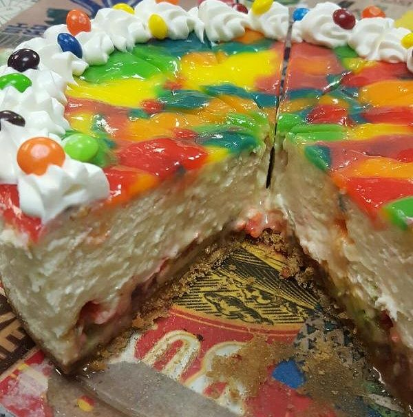 Try one of our delicious cheesecakes like this huge crowd pleasure our skittles cheesecake! #cheesecake #cake #dessert #timmins #radicalgardens #northernontario
