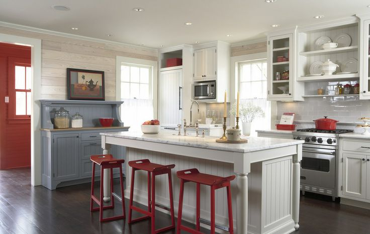 modern farm kitchen with white cabinets and red bar stools around island