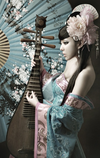 Soft and delicate photo.  Kimono and biwa.