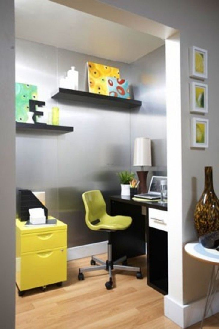 a sleek desk and a bright filing cabinet keep the space simple and wallmounted shelves create more room for