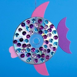 How cute this would be to go along with the book Rainbow Fish!  You could make a whole school of them to hang.