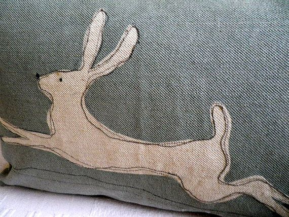 what if you painted shape in bleach on denim then inked outline? cute pillow possibilities ....hand printed muted blue stitched leaping hare by helkatdesign, $72.00