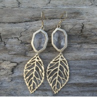 Leaf earrings and clear stone.