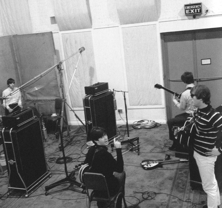 The Beatles in the Abbey Road Studio. VOX stacks and a Rickenbacker on the floor (John's?)