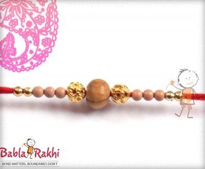 Design Golden Beads Sandwood Rakhi http://www.bablarakhi.com/
