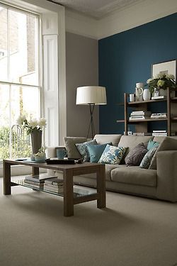 calming living room: feels like home  ** Color scheme - grey couch and blue on walls, patterned pillows