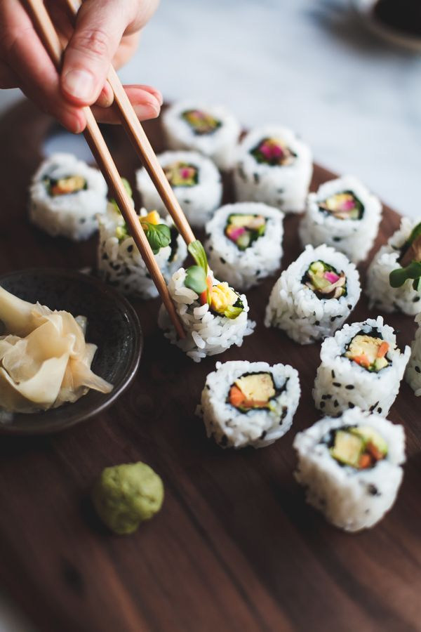 Vegetarian and fishy sushi rolls brim with quick carrot-daikon pickles, shiso, shiitake mushrooms, scallions, avocado, cucumber, shiso, and kaiware sprouts. A how-to guide and a video collaboration…