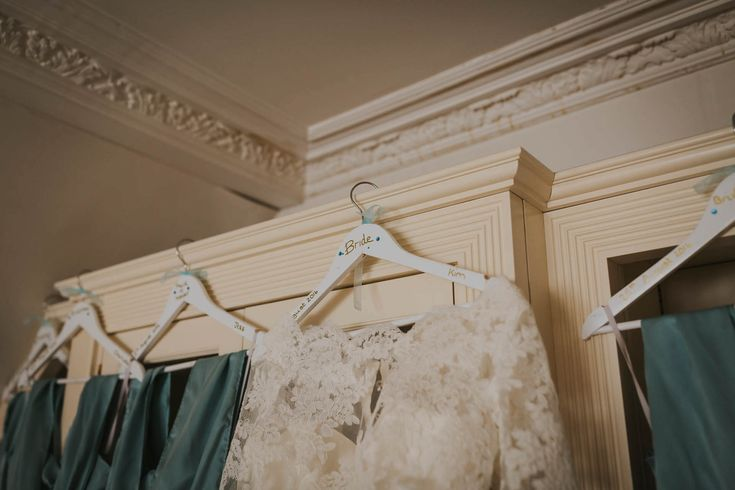 Homemade hangers for the wedding morning are a lovely personal touch. Photo by Benjamin Stuart Photography #weddingphotography #weddinghanger #weddingdress #personaltouch #weddinggift