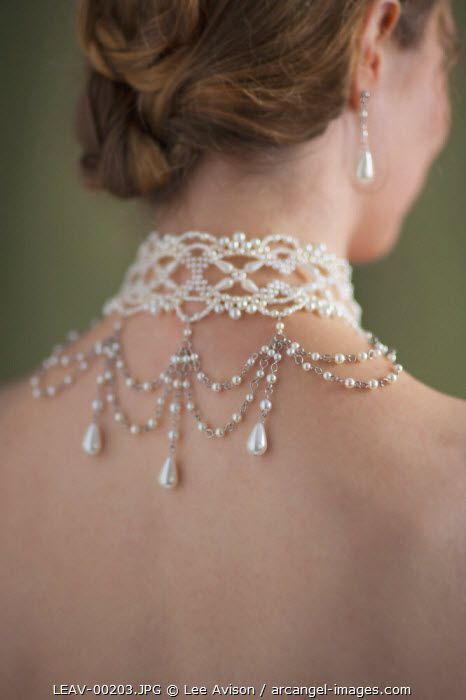 Elaborate pearl necklace choker and matching earrings. Perfect for wedding.
