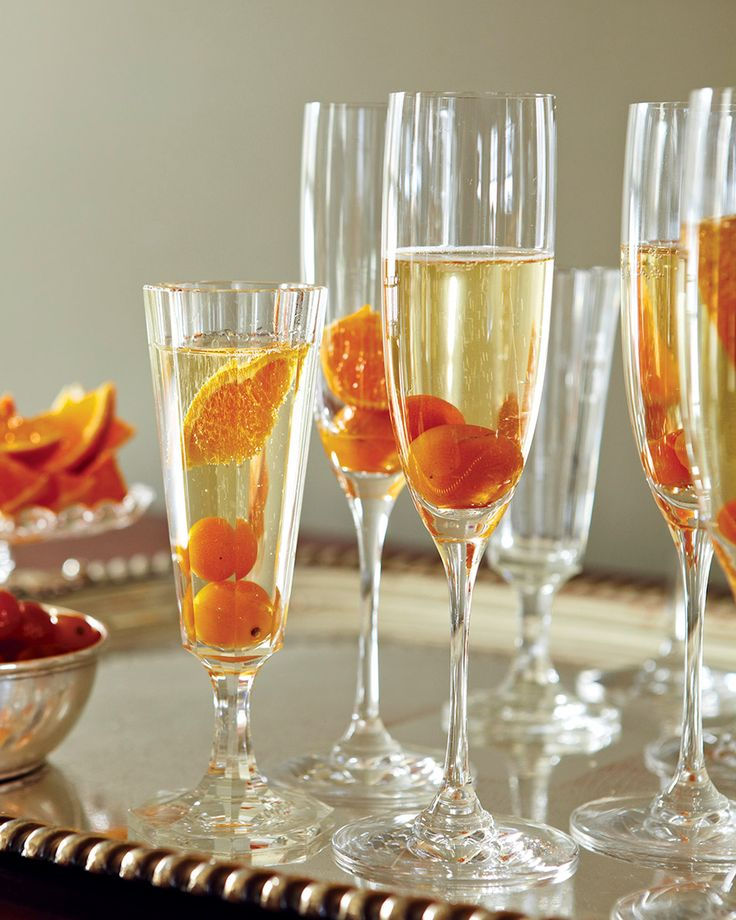 Kumquat-Champagne Cocktails  Candied kumquats are a colorful addition to these celebratory sparkling drinks.
