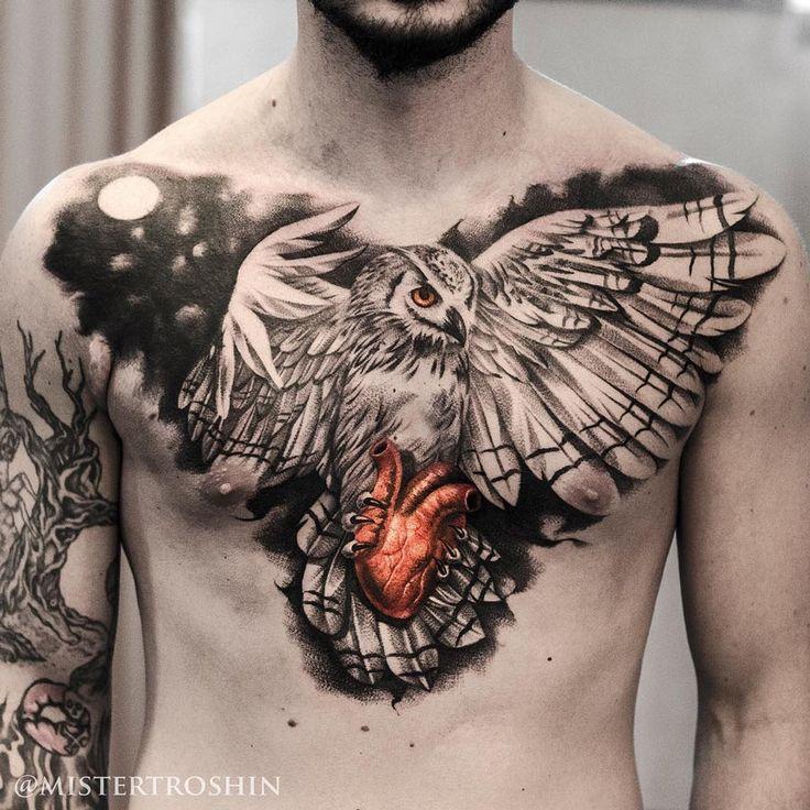 Owl holding heart