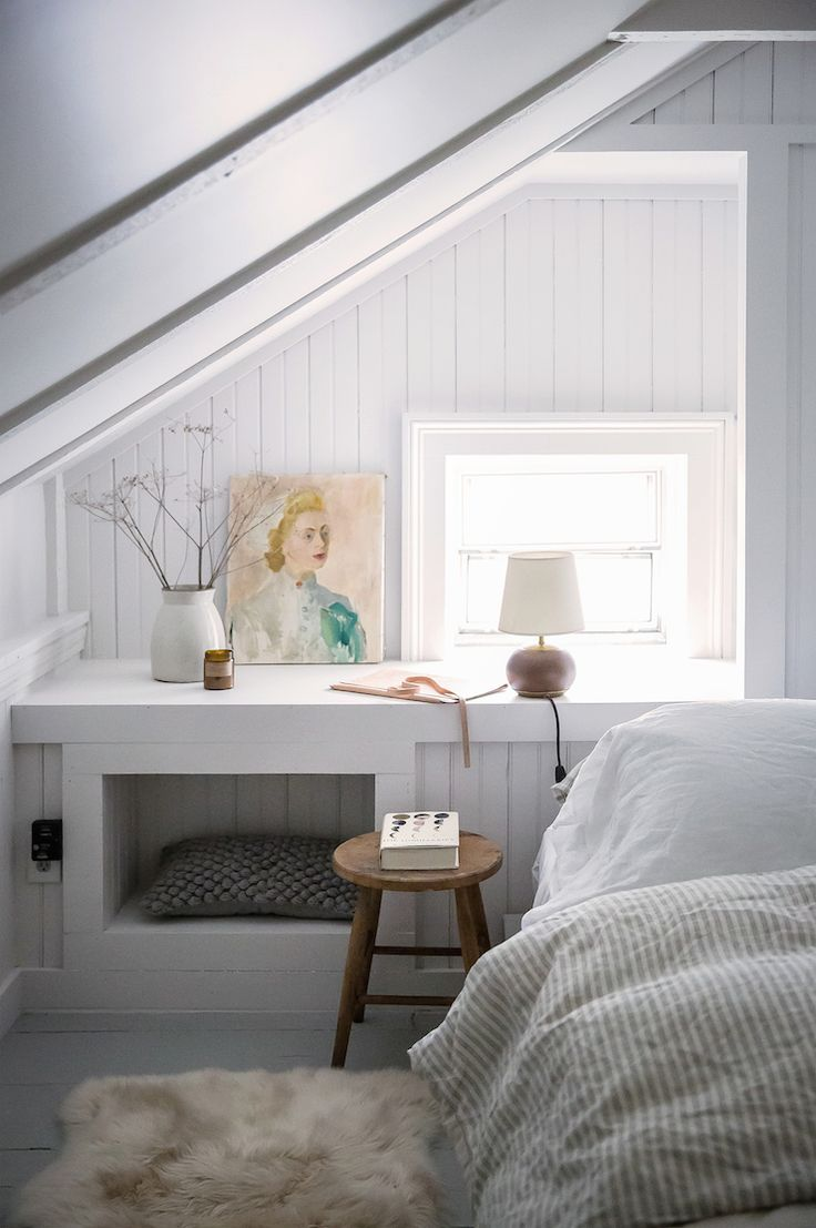 Small white bedroom decor ideas in this white painted paneled attic bedroom with built-in. #whitebedroom #smallbedroom #minimaldecor