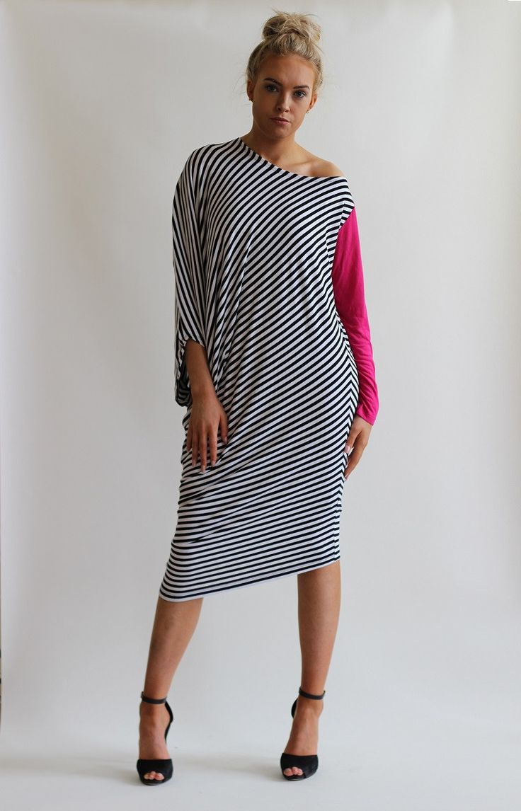Gorgeous striped dress with one loose and one fitted sleeve in acontrasting pink colour. Made from a medium weight jersey blend . The dress has an asymmetric c