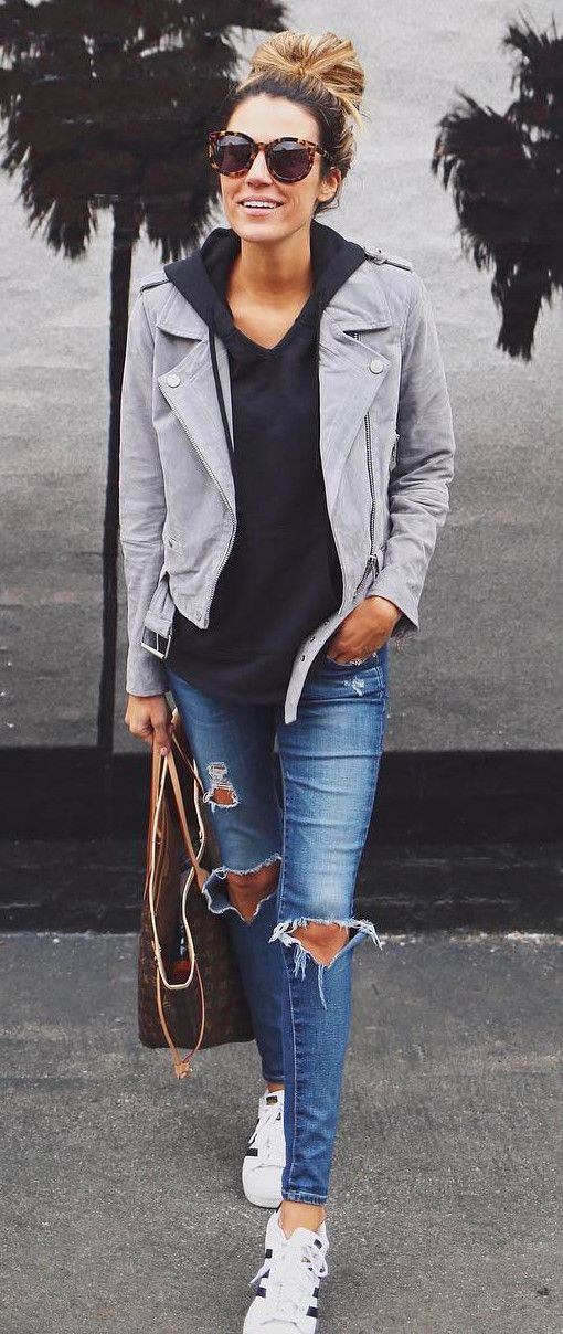 spring has just begun wearing a suede jacket with rips