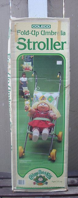 Cabbage Patch Kids Stroller. I had this! I'd put my poor kitty in it lol
