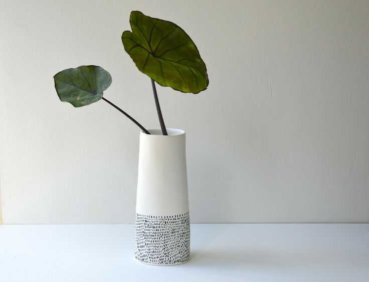 White tall vase with black dash lines