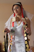 On day two of the wedding celebrations Garoafa Mihai, aged 14, is given her dowry of over 100 gold Franz Josef coins by her family, worth approximately 30,000 USD, prior to her marriage to Florin 'Ciprian' Lulu, aged 13, in Sintesti, Romania, on Sunday, Sept. 24th 2006.  Both are Roma (gypsies) from the village of Sintesti,15 kilometres from Bucharest, Romania. Their partnership was decided by their parents and not through love, and under Romanian law is illegal. The children will neither…