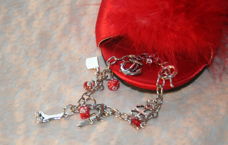 Roller Derby Charm Bracelet: Rockabilly Pin-Up Queen Lucky Gambler Charm Bracelet. $22.95, via Etsy.