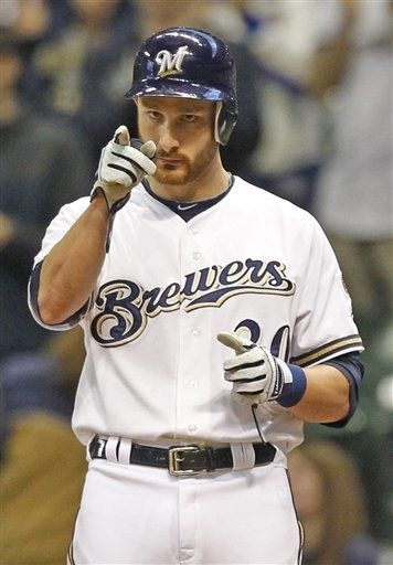 29/162 - Brewers 8, Cincinnati 3 - Brewers' Jonathan Lucroy reacts after his two-RBI base hit against the Cincinnati Reds during the first inning - (May 8)