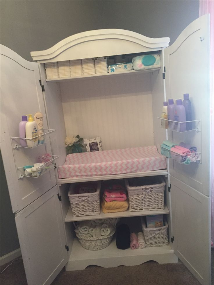 Armoire repurposed as changing table/storage. Tiny room friendly!