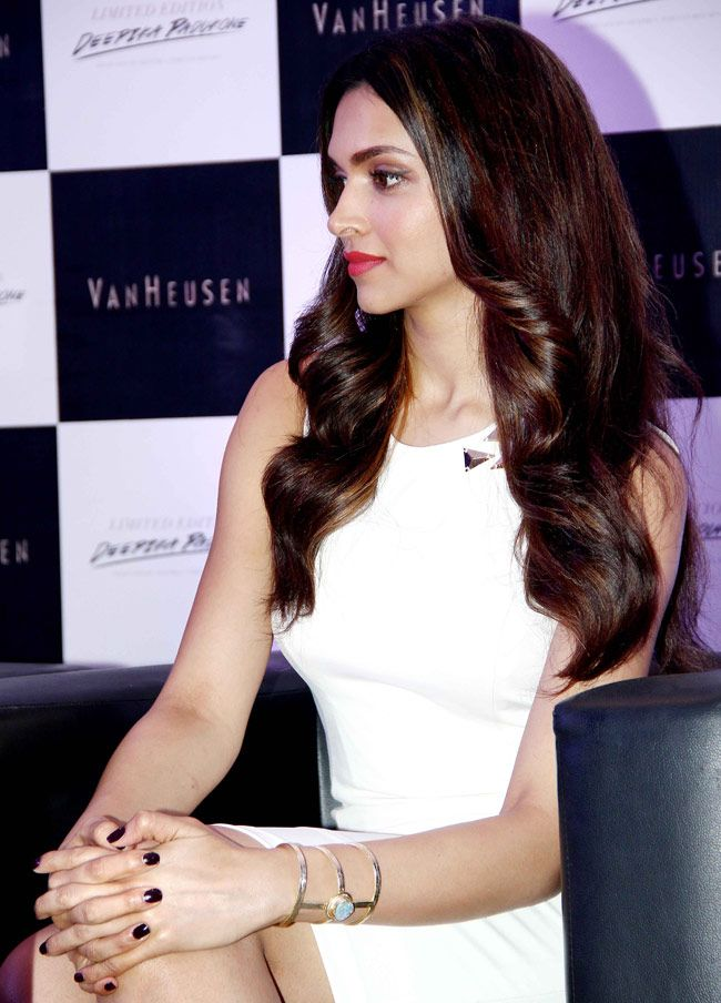 Deepika Padukone looks classy in chic in a white dress at a Van Heusen event. #Style #Bollywood #Fashion #Beauty