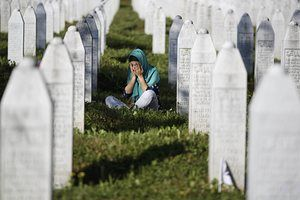 A woman mourns at the Memorial Centre Potocari, near Srebenica, Bosnia and Herzegovina. Ceremonies were held to mark the 20th anniversary of the Srebrenica massacre. Abandoned by their UN protectors toward the end of the 1992-95 war, 8,000 Muslim men and boys were executed by Bosnian Serb forces over five July days, their bodies dumped in pits then dug up months later and scattered in smaller graves in a systematic effort to conceal the crime.