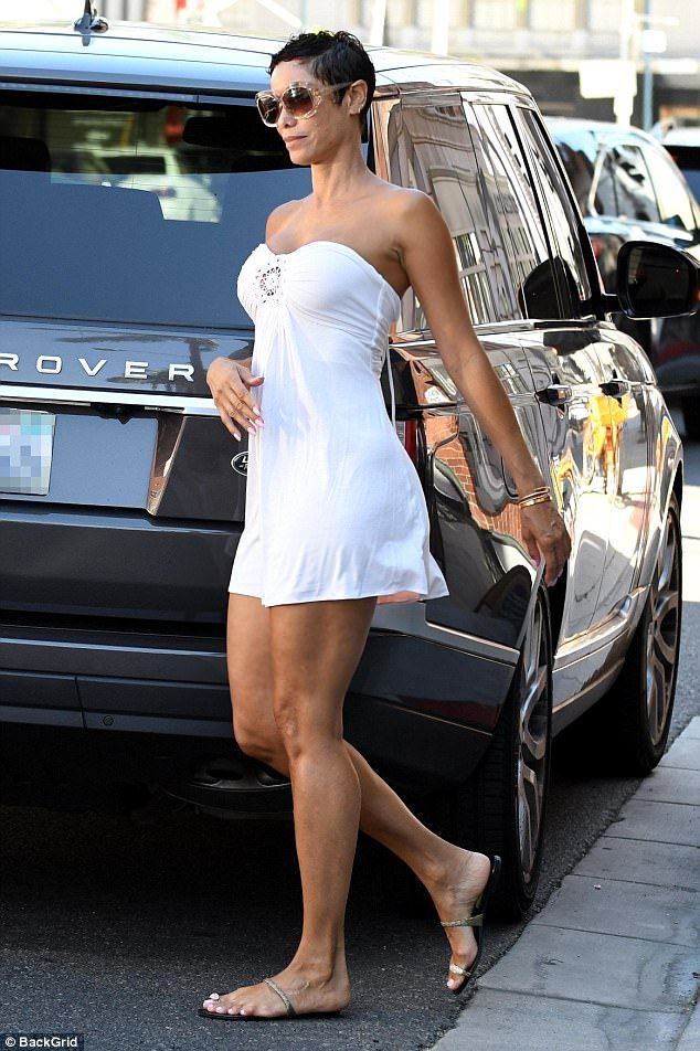 Summer lover: The Nicole Murphy oozed summer chic in a strapless white dress which expertly featured her fantastic figure as she took her mom to the doctor in Beverly Hills